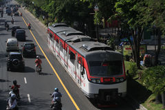 Railbus. Was speeding in the middle of the rail town of Solo, Central Java, Indonesia Stock Image