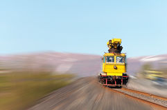 Railcar move along the railway. Royalty Free Stock Photo
