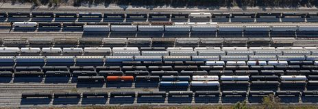Railcar pattern overhead aerial. Almost straight down aerial with pattern of rail cars in train yard Stock Photos