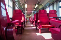 Railcar with red seats Stock Photography