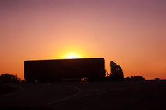 Railer goes on  motorway against sunset Stock Image