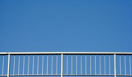Railing. Of a bridge with a blue empty sky at the background Stock Photo