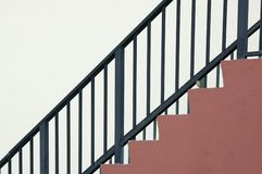 The railing. Metal railing of concrete staircase,looking like a graph going up on white Royalty Free Stock Images