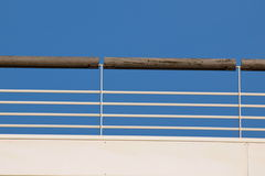 Railing against a blue sky. Brown railing against a blue sky Royalty Free Stock Photography