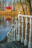 Railing with balusters on the background of a wooden cottage Royalty Free Stock Photo