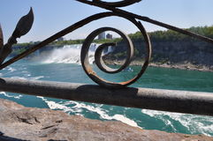 Railing design at Niagara Falls, Canada. Rushing water waterfalls brass rail old-fashioned design at historic landmark across from nyc royalty free stock photography