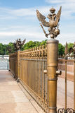Railing with double-headed eagles around the Alexander Column on Palace Square in St. Petersburg. Cast-iron railing with double-headed eagles around the Stock Photos
