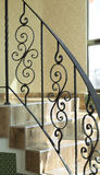 Railing internal stairs in a building. Made of wrought iron Royalty Free Stock Image