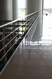 Railing, marble floor on business area royalty free stock photography