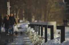 Railing beside pavement in people full in a city royalty free stock photography