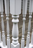Railing Posts. White railing posts on a deck Royalty Free Stock Photo
