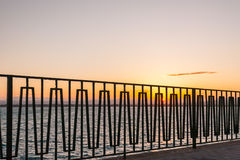 Railing by the sea Stock Photo