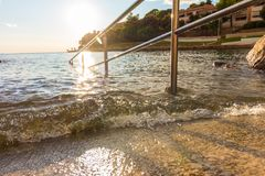 Railing at the sea. Railing at the adriatic sea on a sunny day Royalty Free Stock Images