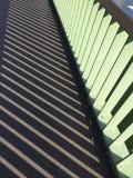 Railing shadow on a bridge. Railing sidewalk shadows Royalty Free Stock Photo