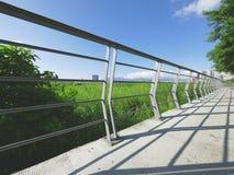Railing and sidewalk Stock Photo