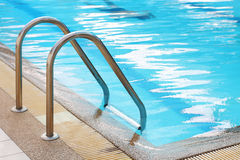 Railing stairs down to the pool Stock Image
