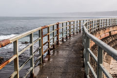 Railing and Walkway of Children's Pool, on Cloudy Day Royalty Free Stock Image