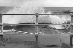 Railing and wave a Stock Images