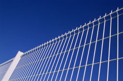 Railings. White painted steel railings between inside and outside as a protection against any danger, blue sky background Royalty Free Stock Images