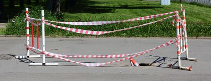 The railings of the barriers. And striped tape stock images