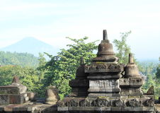 Railings on Borobudur with volcano Stock Photos