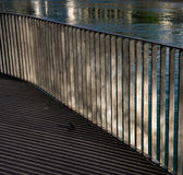 Railings. Highlights and the reflecting surface of the bridge railings Royalty Free Stock Image