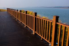 Railings on the lakeside plank road Royalty Free Stock Photo