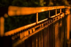 Railings at night. At night, lights shine on the iron railings. Screws, nuts, steel rods royalty free stock images