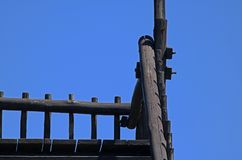 RAILINGS AND POSTS AGAINST A BLUE SKY ABSTRACT. Wooden posts and railings against a blue sky Stock Images
