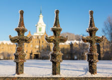 Railings in snow outside Trans-Allegheny Lunatic Asylum. Close up of cast iron railings outside Trans-Allegheny Lunatic Asylum in Weston, West Virginia, USA royalty free stock photography