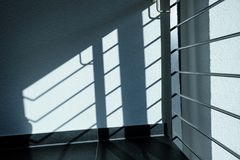 Railings in stair as shadow on the wall. With plaster Royalty Free Stock Images