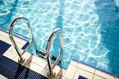 Railings and water. Steel railings by edge of swimming pool with pure water Stock Photos