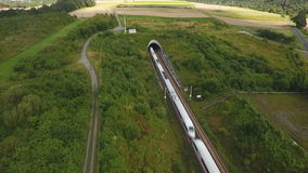 Railraod track and tunnel - aerial view. Drone footage stock video footage