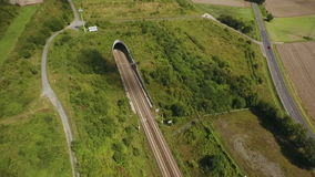 Railraod track and tunnel - aerial view. Drone footage stock footage