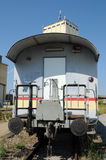 Railroad 067. A railroad car in front of a storage building stock photos