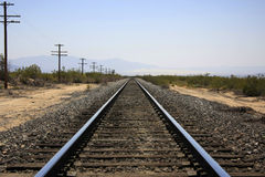 Railroad. In the desert  with vanishing point Royalty Free Stock Image