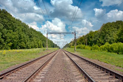 Railroad. Tracks in the blue sky and clouds Royalty Free Stock Images