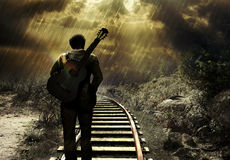 On the railroad. Man with a guitar on his back, walking by the railroad, under the rain. A rainbow comes out from his guitar vector illustration