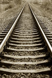 Railroad. A vertical shot of railroad tracks extending to the horizon Royalty Free Stock Images