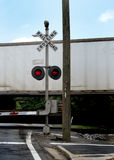 Railroad. Crossing with speeding train Royalty Free Stock Photography