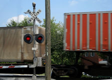 Railroad. Crossing with speeding train Royalty Free Stock Photos