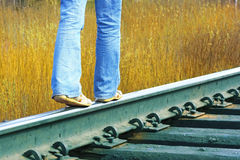 Railroad. Walking on railroad's edge near yellow grass Stock Images