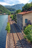Railroad along river in Italy Royalty Free Stock Image
