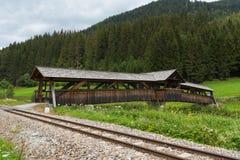 Railroad along the river Mur and an ancient wooden bridge, Austria, alpine landscape Royalty Free Stock Image