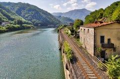 Railroad along the river Serchio Stock Photo