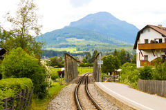 Railroad in alpine town Royalty Free Stock Images