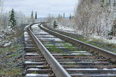 Railroad amongst snowy forest. Royalty Free Stock Photos
