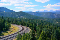 Railroad Bend Curve in the Mountains on a Sunny Day.  Stock Photos