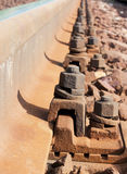Railroad bonding. Railroad metal, sleepers and rusty bonding screws Stock Photography