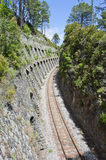 Railroad bordered by rocks in Corsica, France Royalty Free Stock Images